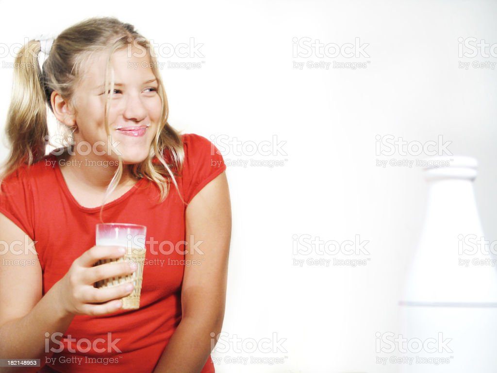 Teenage girl holding a glass of milk royalty-free stock photo