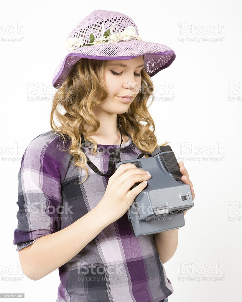 Teenage girl holding a polaroid camera royalty-free stock photo