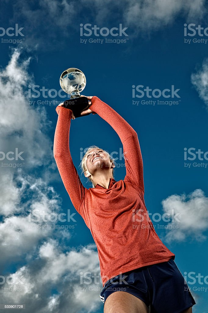 Teenage Girl Holding a Soccer Trophy stock photo