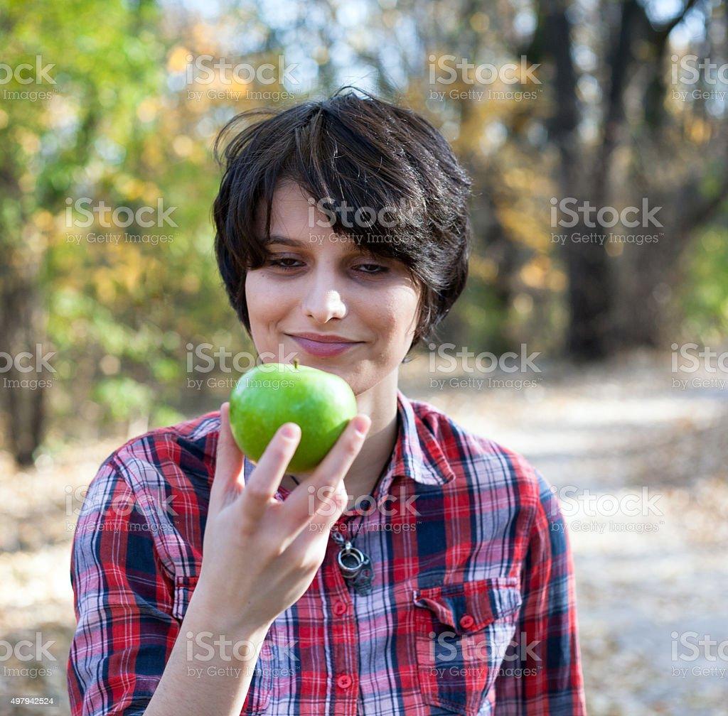 Teenage girl holding an apple royalty-free stock photo
