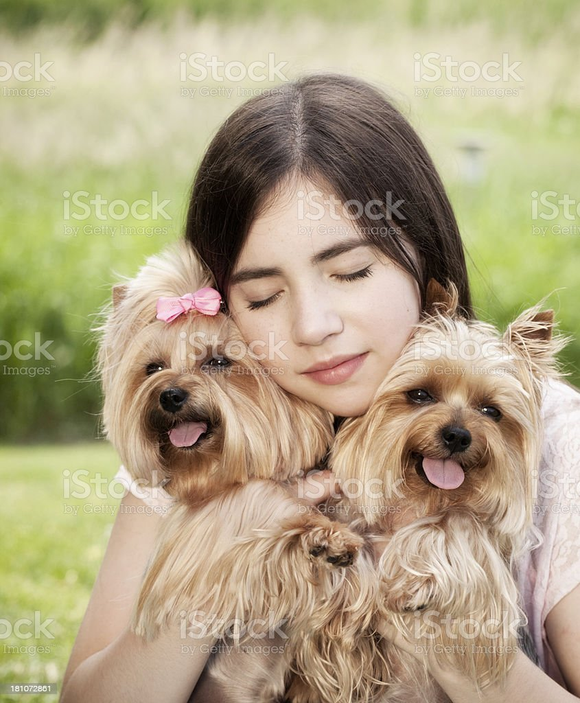 Teenage girl holding her Yorkshire Terrier dogs royalty-free stock photo