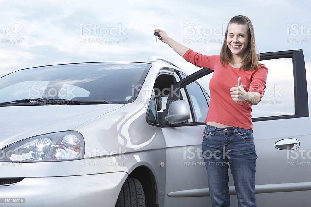 Teenage girl holding keys of new car stock photo