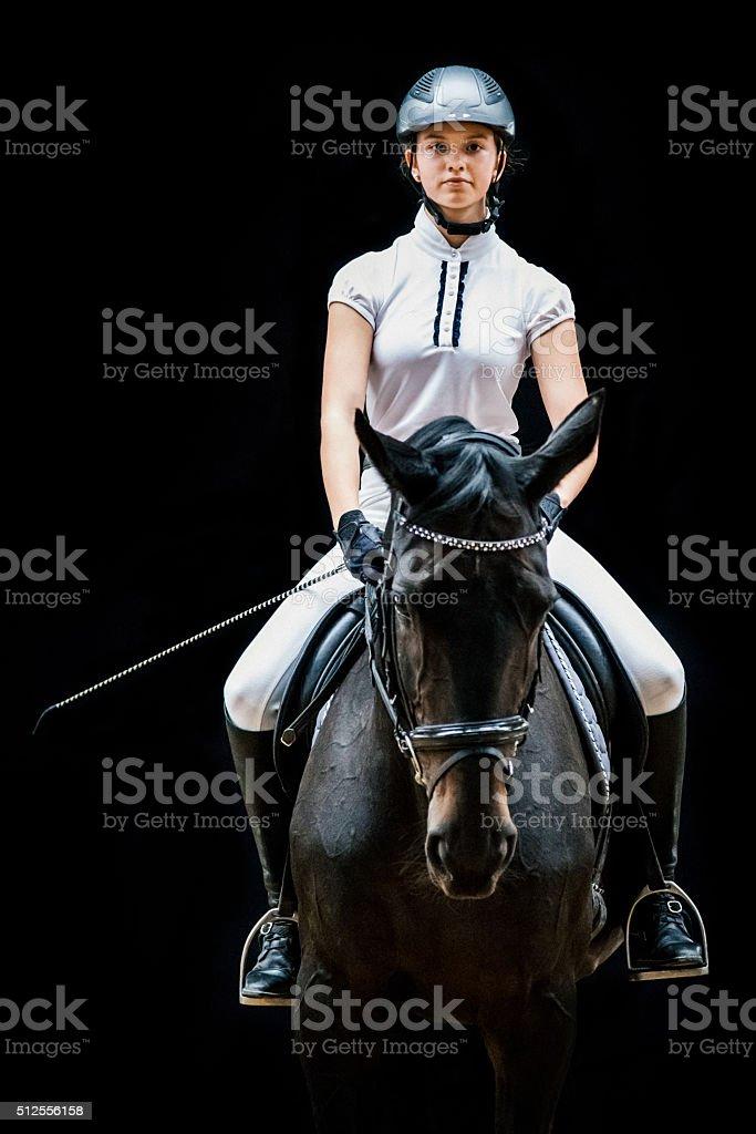 Teenage Girl Horseback Riding Equestrian Portrait stock photo