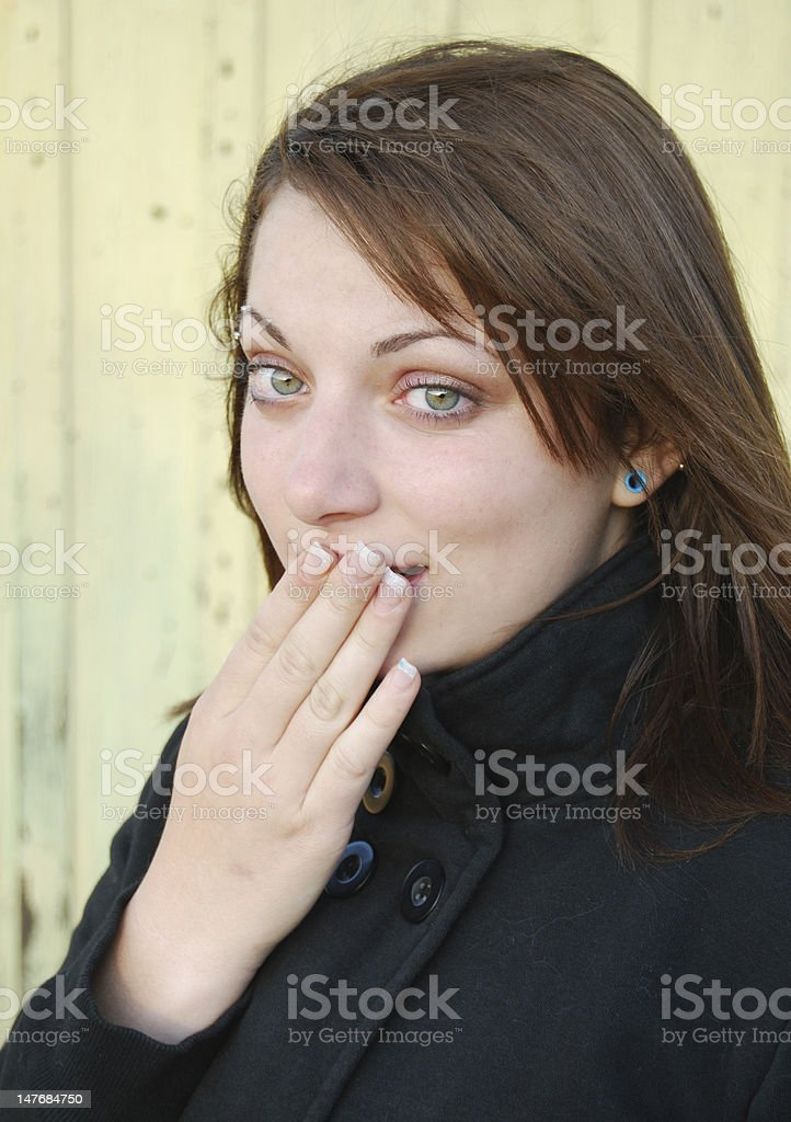 teenage girl hush stock photo