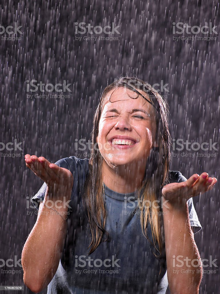Teenage girl in a rain stock photo
