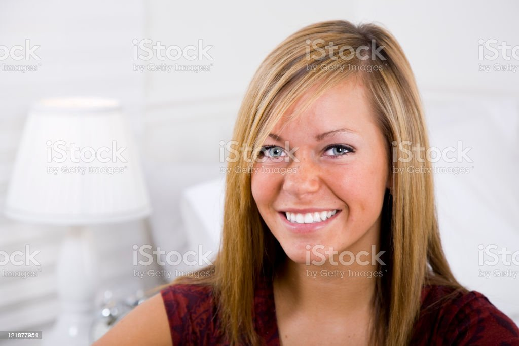 Teenage Girl in a White Bedroom royalty-free stock photo