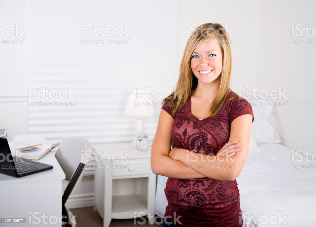 Teenage Girl in a White Bedroom stock photo