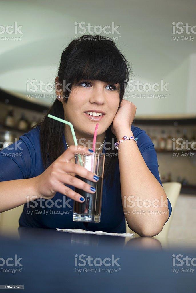 Teenage girl in bar royalty-free stock photo