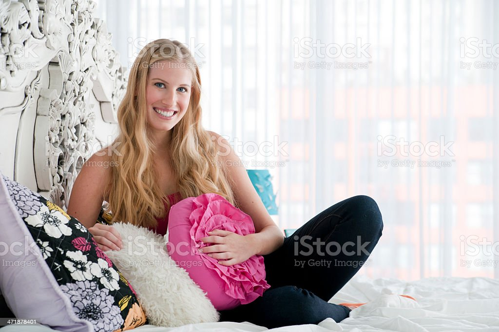 Teenage girl in her bedroom royalty-free stock photo