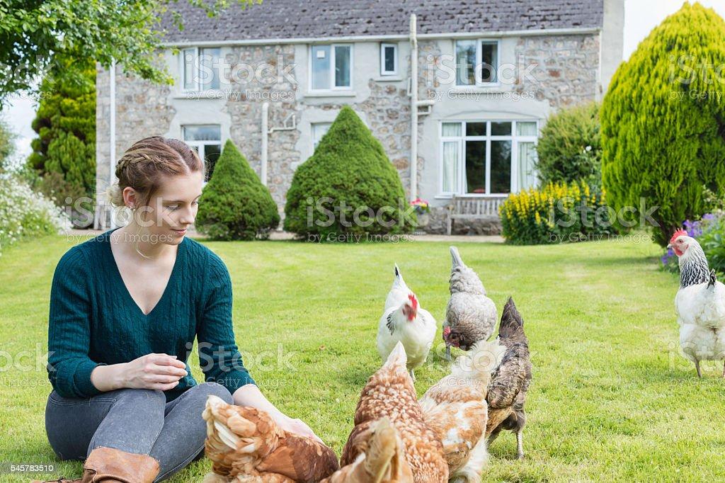 Teenage Girl In Her Garden With Hens stock photo