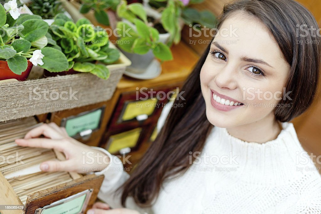 Teenage girl in library searching stock photo