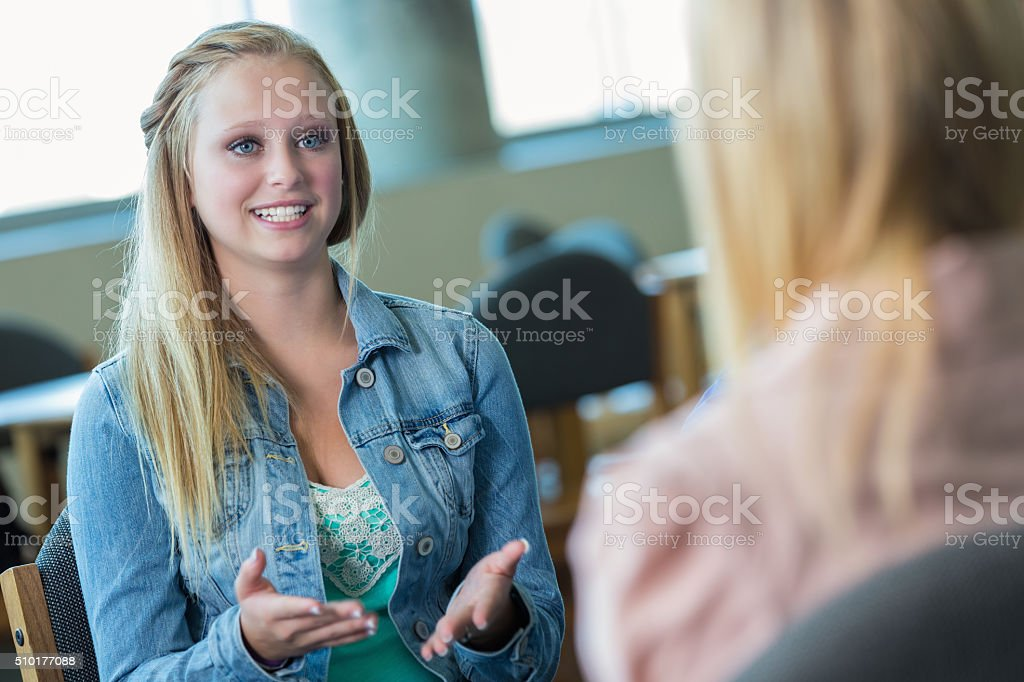 Teenage girl in therapy session stock photo