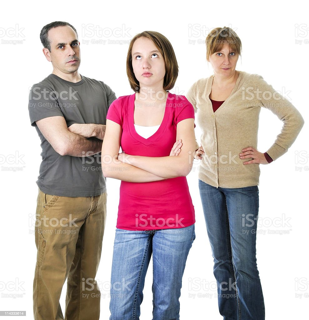 Teenage girl in trouble with parents royalty-free stock photo