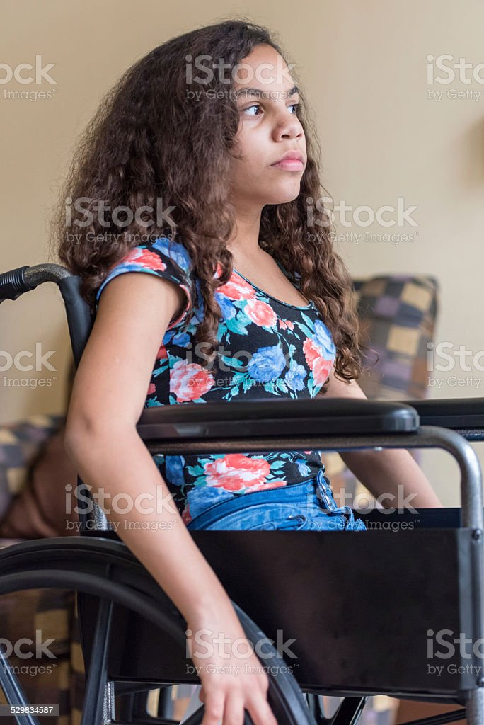 teenage girl in wheel chair stock photo