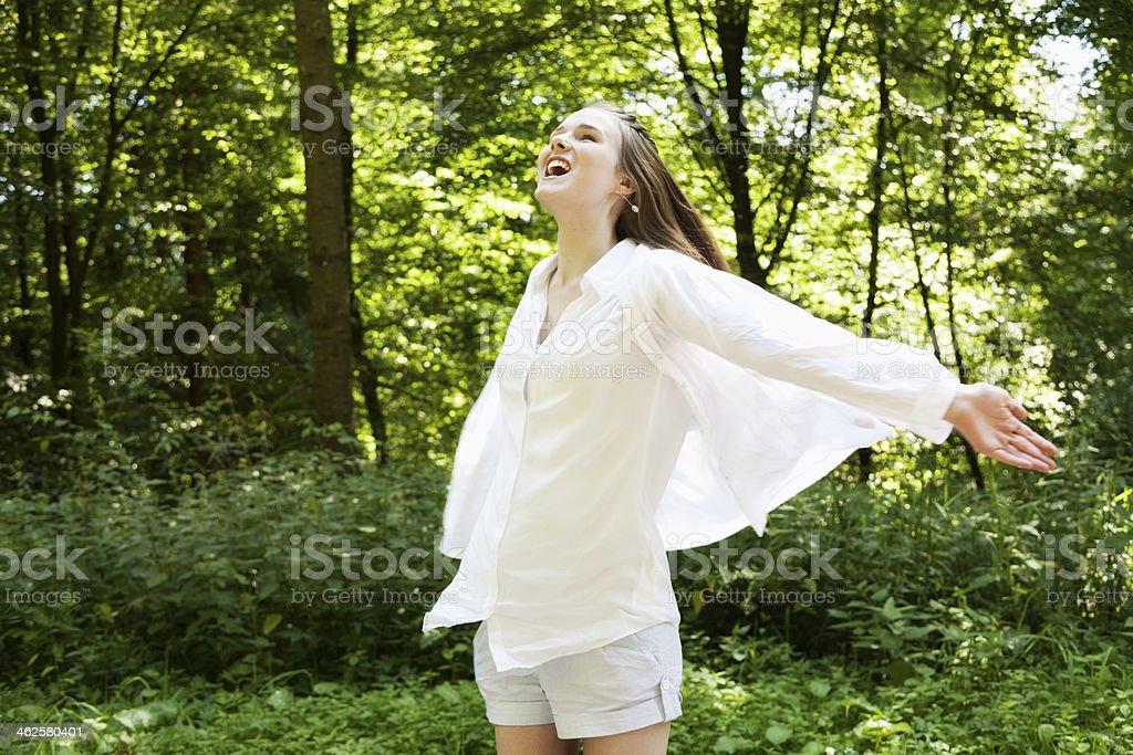 teenage girl in woods dancing enjoying life royalty-free stock photo