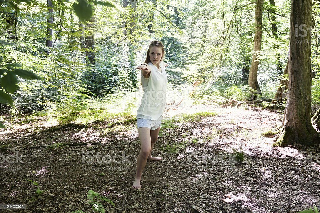 teenage girl in woods doing yoga royalty-free stock photo