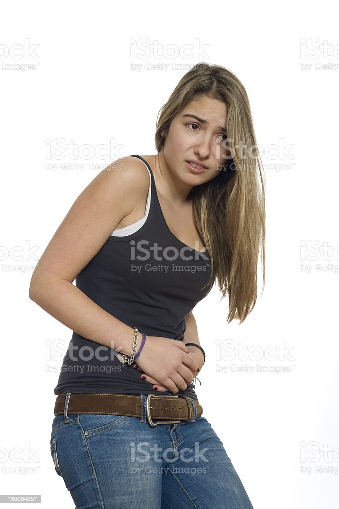 Teenage girl is affected by stomach cramps stock photo