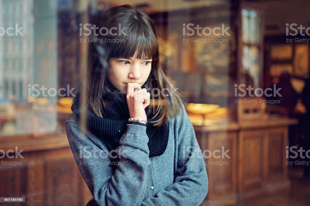 Teenage girl is looking museum exhibition stock photo