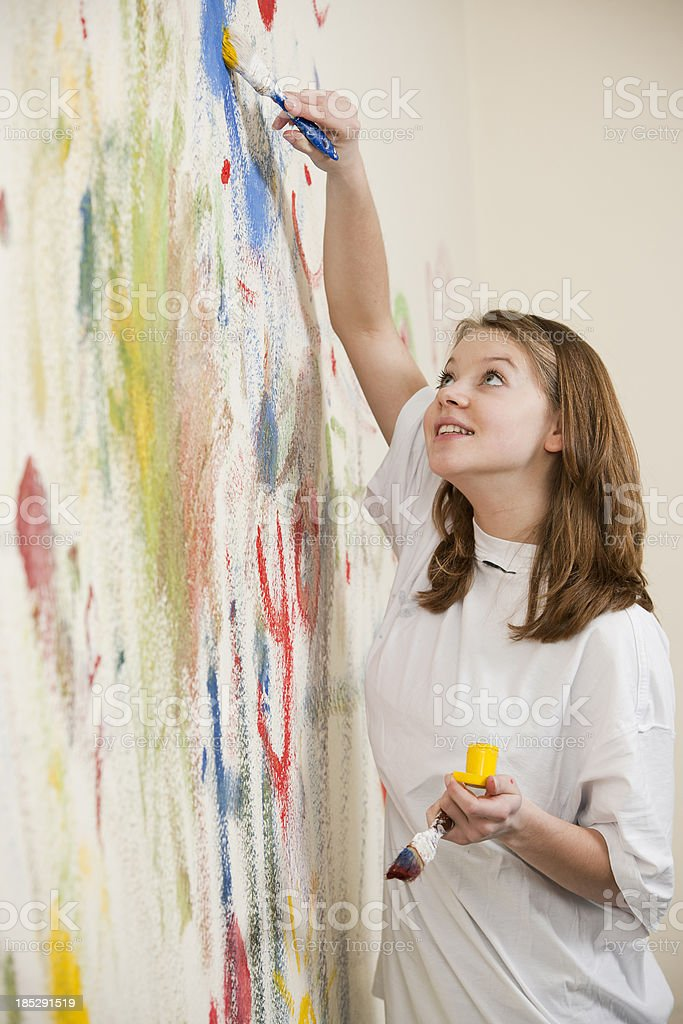 Teenage girl is painting royalty-free stock photo