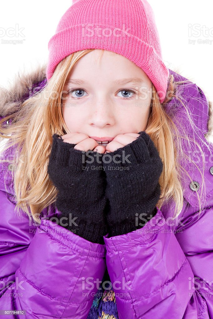 Teenage girl is posing in winter outfit over white backgroung stock photo