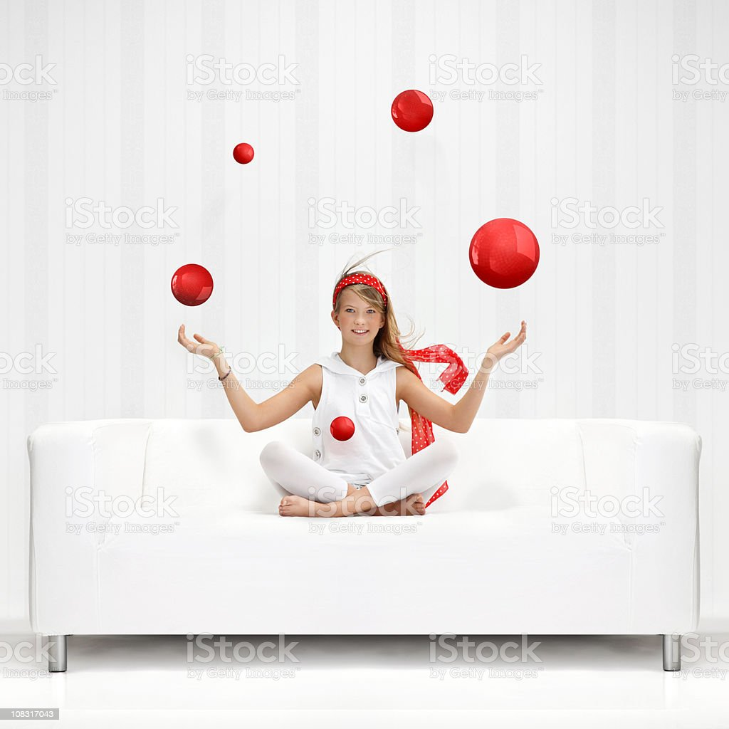 Teenage girl juggles with red balls royalty-free stock photo