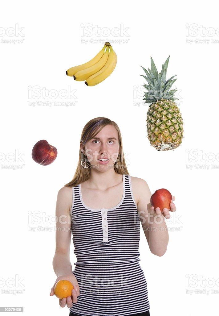 Teenage girl juggling fruit royalty-free stock photo