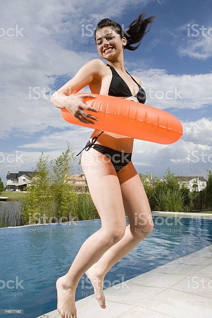Teenage girl jumping royalty-free stock photo