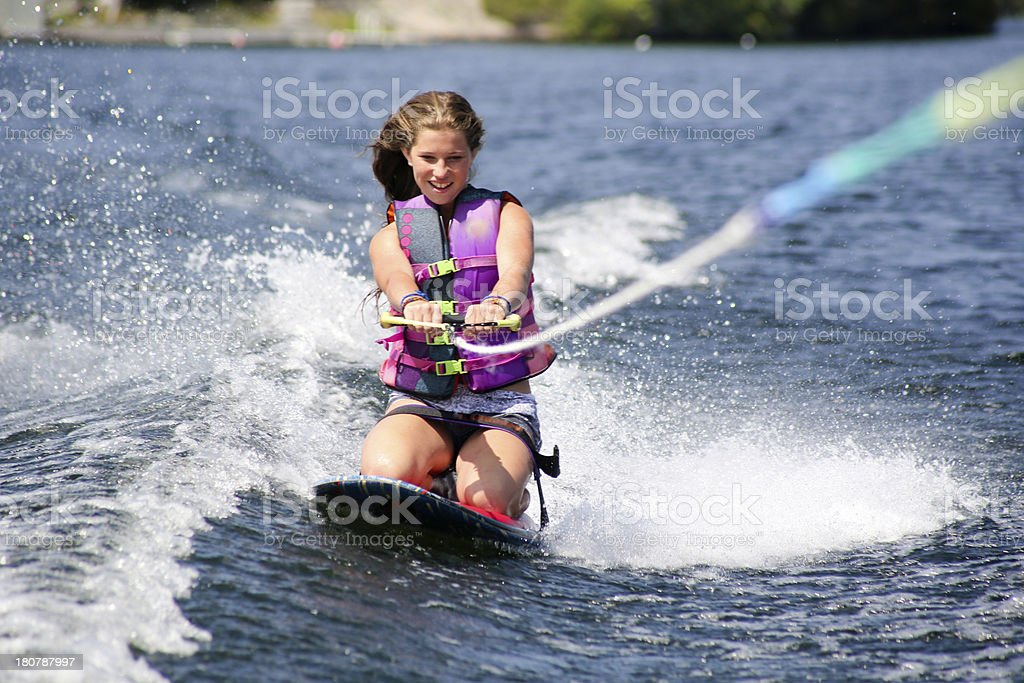 Teenage Girl Kneeboarding in Muskoka, Ontario, Canada stock photo