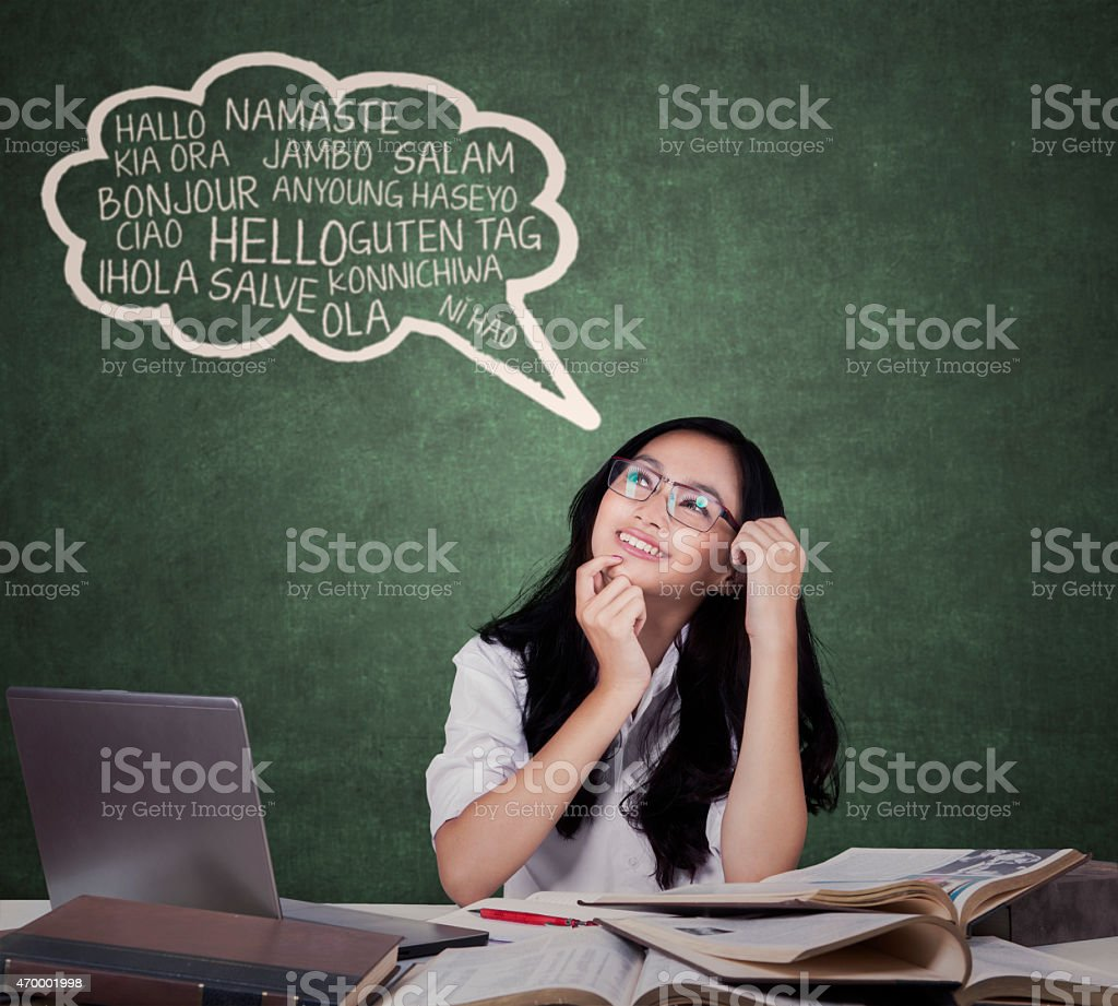 Teenage girl learning foreign languages stock photo