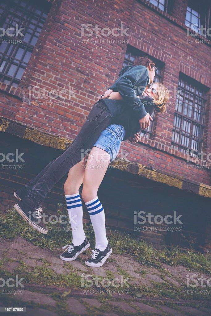 Teenage Girl Lifting Hipster Boy for Fun royalty-free stock photo