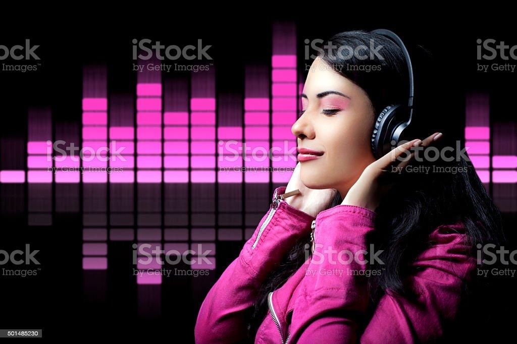 Teenage girl listening music stock photo