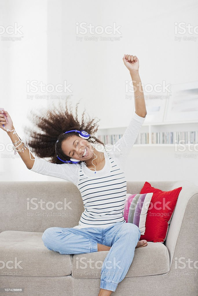 Teenage girl listening to mp3 player royalty-free stock photo