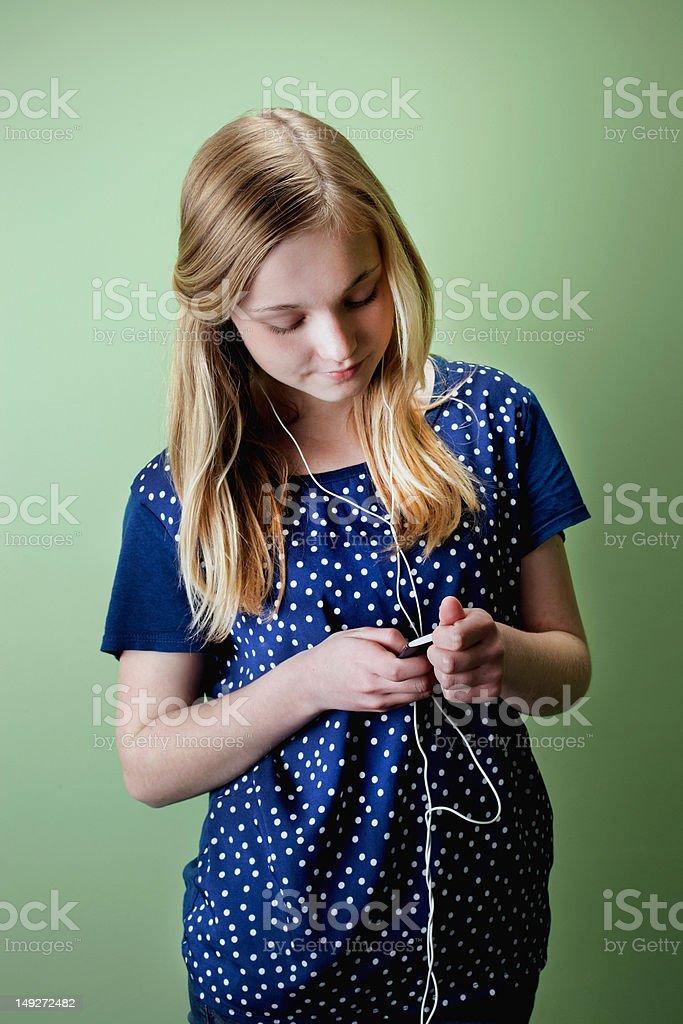 Teenage girl listening to mp3 player stock photo