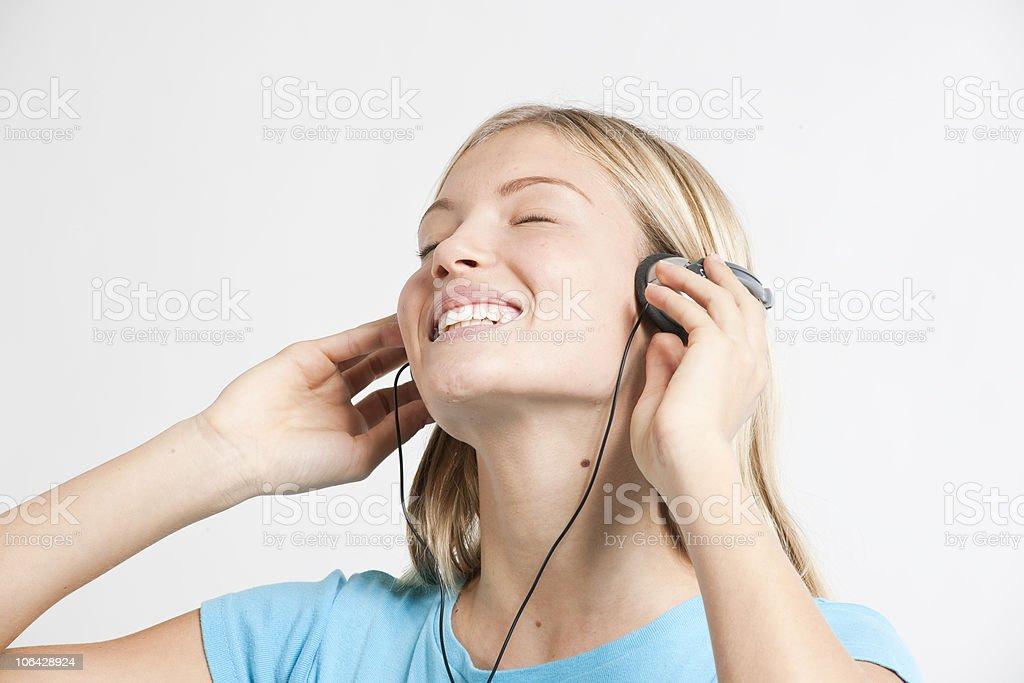 Teenage girl listening to the music stock photo