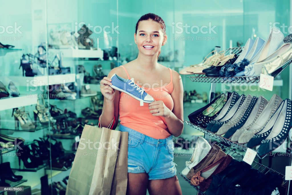teenage girl looking after shoes stock photo