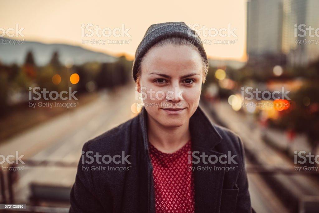 Teenage girl looking at camera stock photo