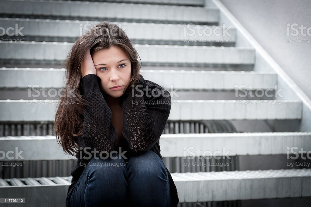 Teenage girl looking thoughtful about troubles royalty-free stock photo