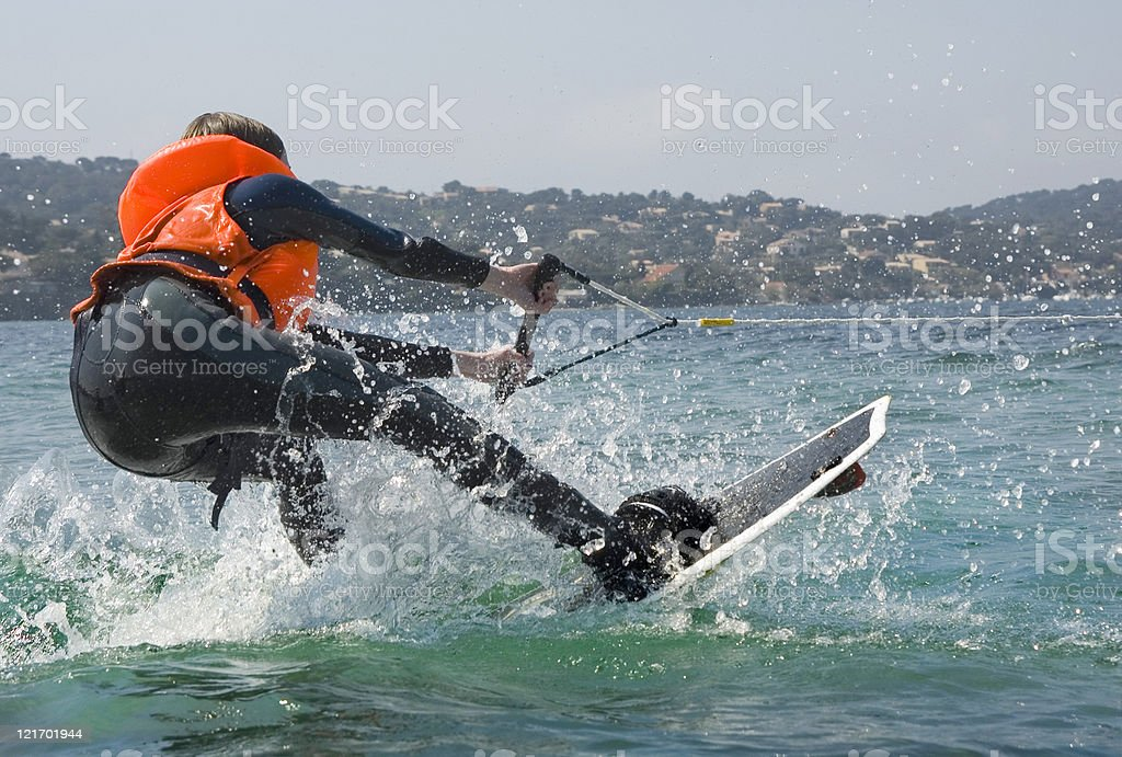 Teenage girl loosing the balance on her wakeboard royalty-free stock photo