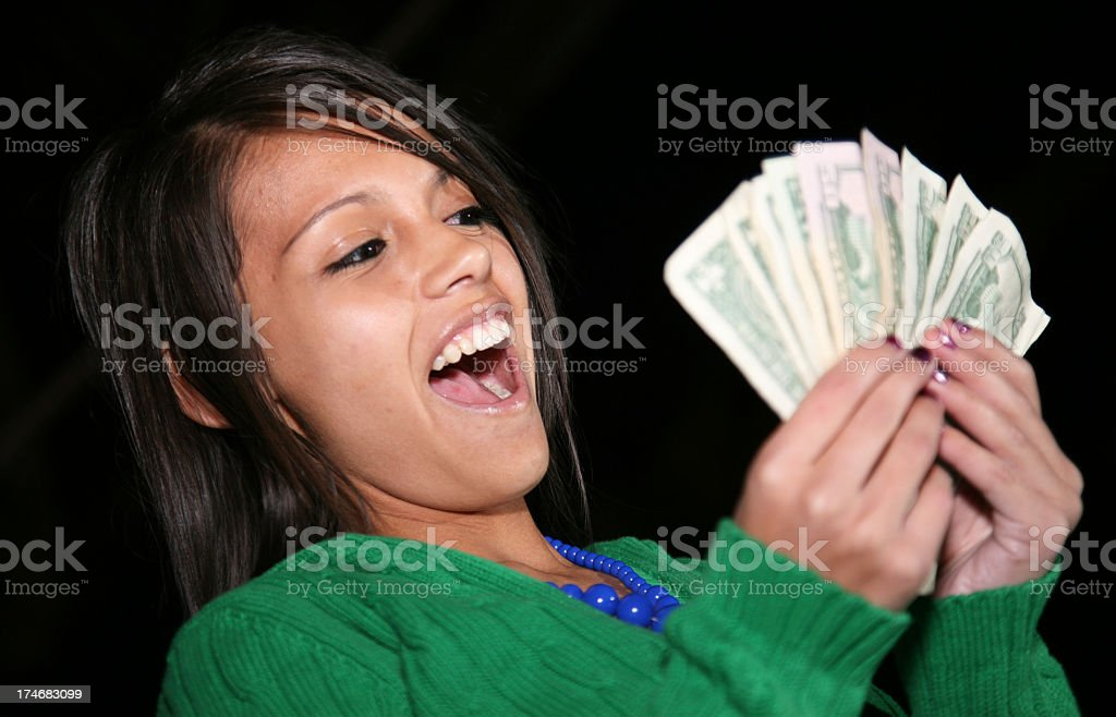 Teenage Girl Loving the Cash! royalty-free stock photo