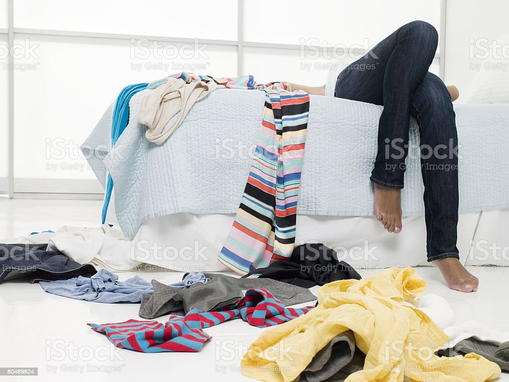 A teenage girl lying on a bed stock photo