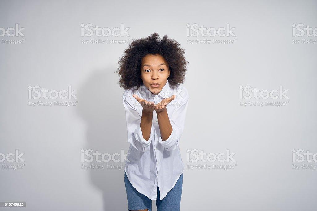 Teenage Girl Making Flying Kiss stock photo