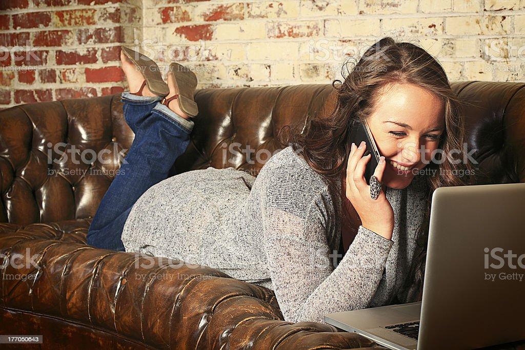 Teenage Girl Networking on Sofa royalty-free stock photo