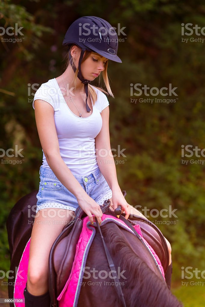 Teenage girl on a horse stock photo