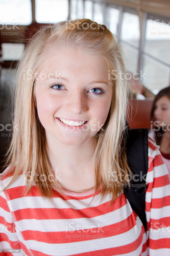 Teenage Girl on a School Bus royalty-free stock photo