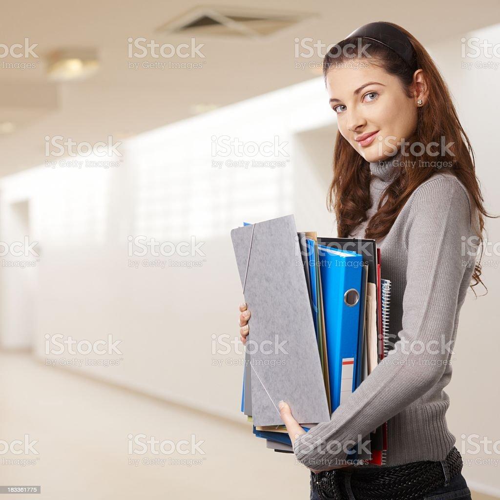 Teenage girl on school corridor royalty-free stock photo