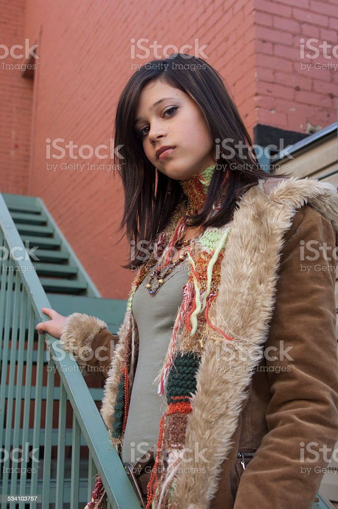 Teenage Girl on Steps in Winter Coat and Scarf stock photo