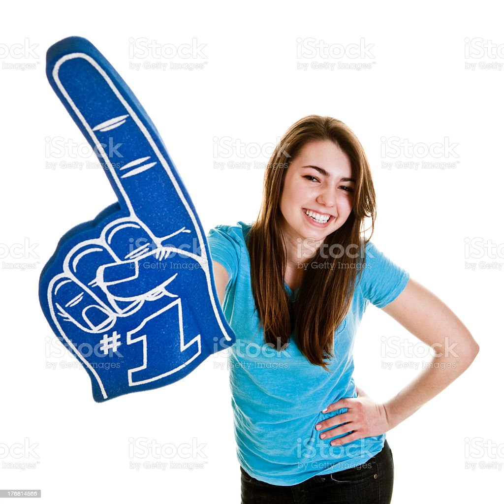 Teenage girl on white with blue foam finger royalty-free stock photo