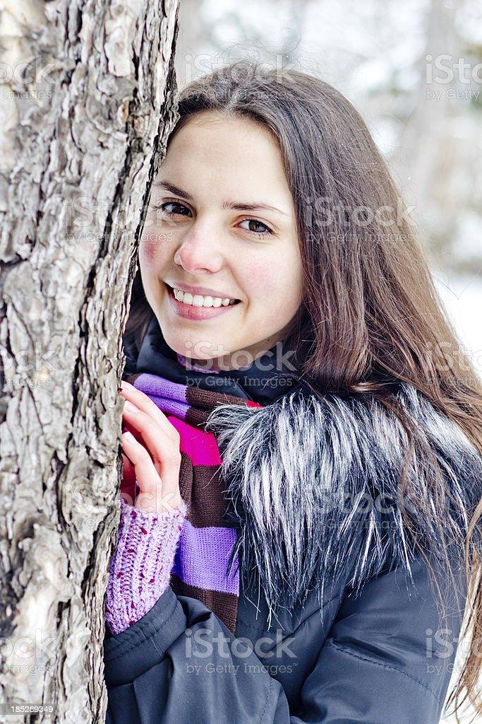 Teenage girl outdoors winter smiling portrait stock photo