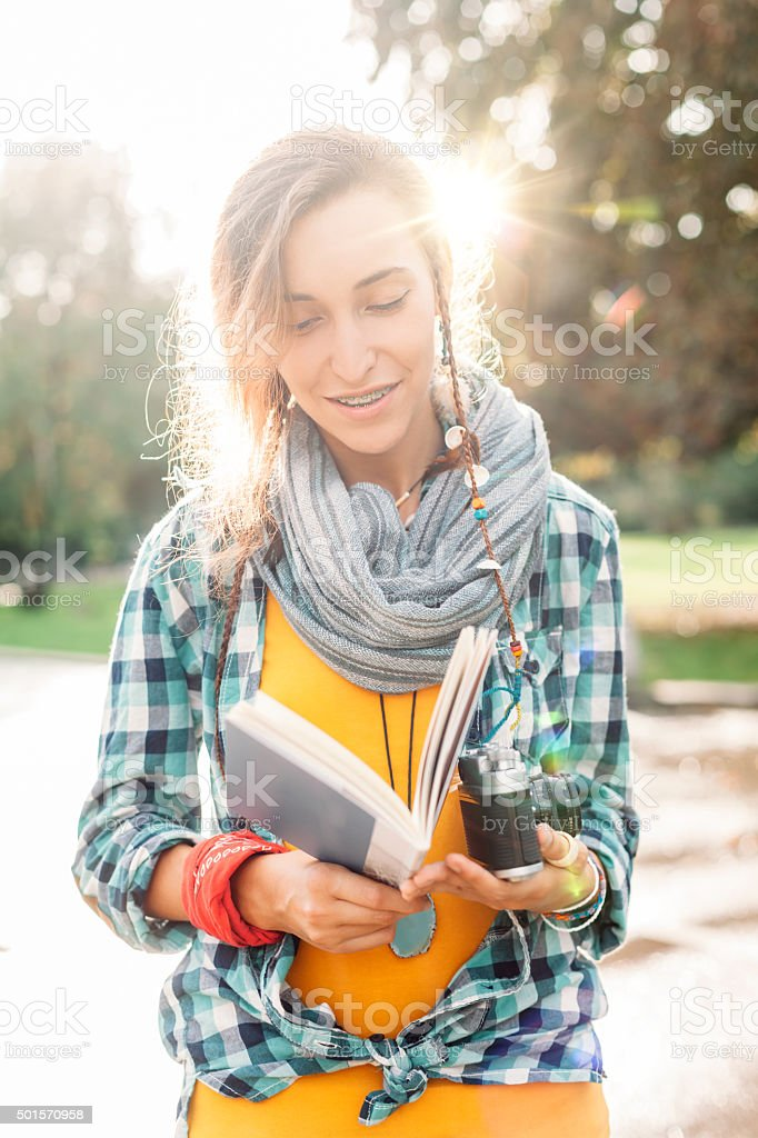 Teenage girl outside learning how to make photos stock photo
