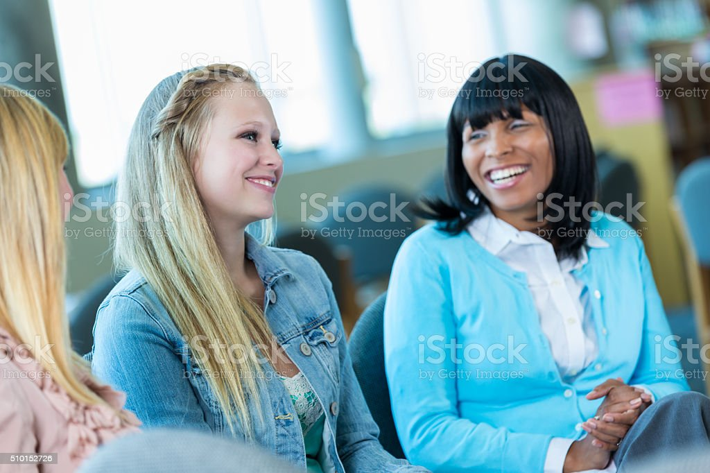 Teenage girl participates in group therapy stock photo